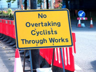 Roadsign -'No overtaking cycists through works'